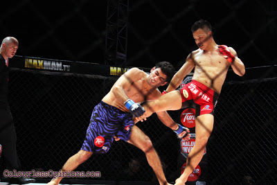 Saiful Merican kicking Aditya at MIMMA Grand Finals ONE FC Superfight bout