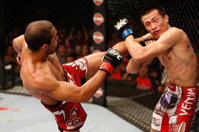 Jose Aldo kicking Korean Zombie Chan Sung Jung's dislocated shoulder in UFC 163