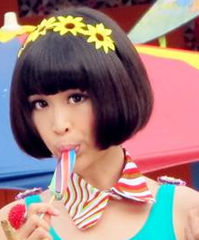 Ribbon Ooi sucking on lollipop in Kara King