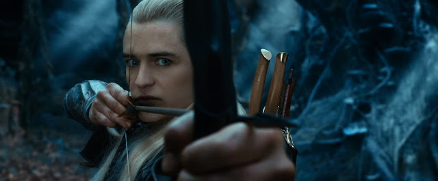 Orlando Blood as Legolas with bow & arrow action in The Hobbit 2: Desolation of Smaug