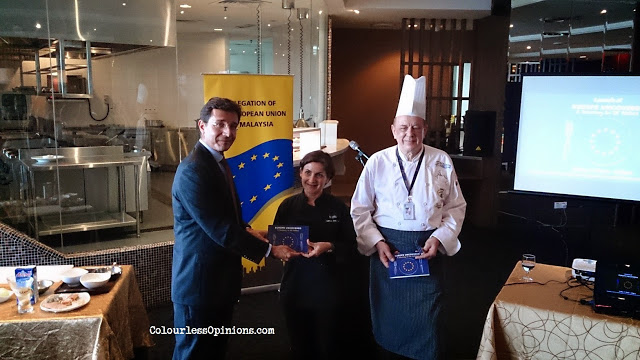 EU Delegation's Charge d'affaires a.i. Alessandro Paolicchi presenting the cookbook to Chef Nathalie Aberfeuille and Jochen Kern at Europe Uncovered A Journey of 28 Dishes media launch in KL Malaysia