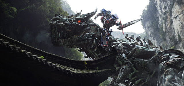 Transformers 4 Age of Extinction movie still - Optimus Prime on Grimlock Dinobot
